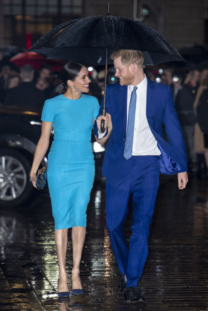 Meghan Markle Smiles in Blue Dress and Sleek Ponytail With Husband Prince Harry in Blue Suit While Raining
