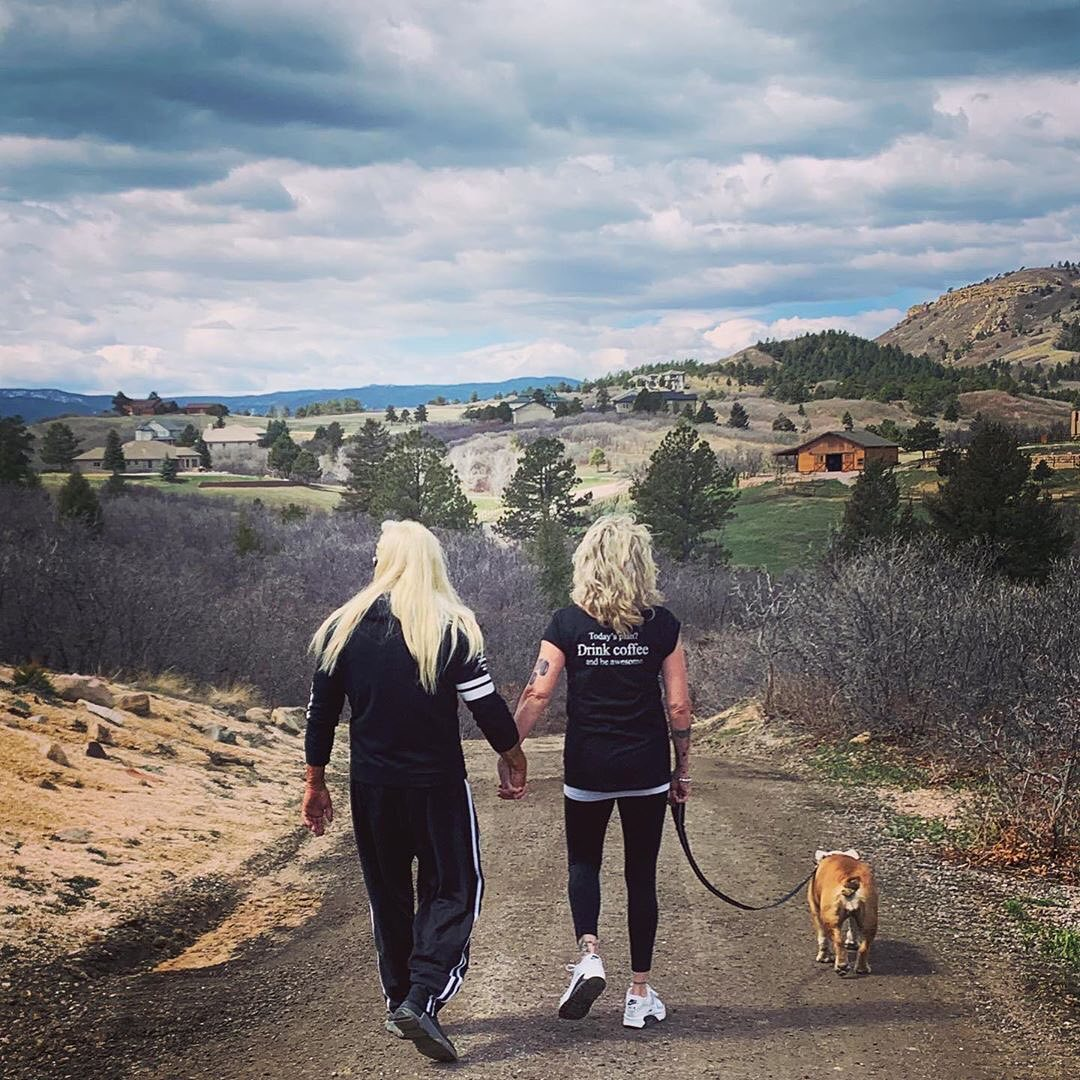 Duane Chapman and Fiance Francie Frane Walking Dog Outside