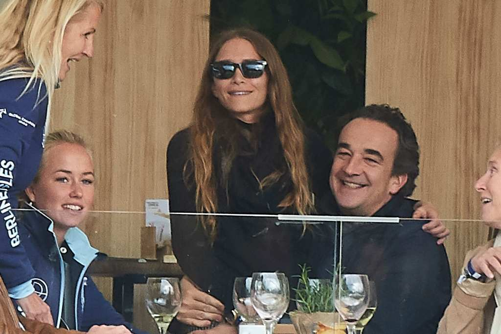 Mary Kate Olsen and Estranged Husband Olivier Sarkozy Laugh WHile She Sits on His Lap