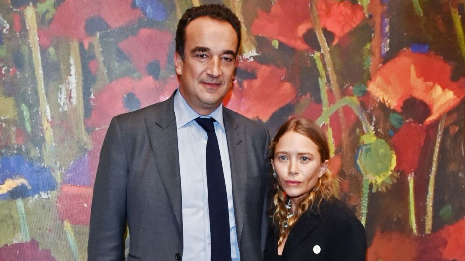 Mary-Kate Olsen Wears Baggy Black Coat With and Ex Husband Olivier Sarkozy in a Grey Suit at Event