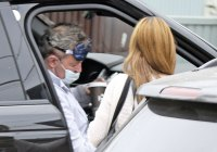 Matthew Perry Looks Exhausted in Sleeping Mask as Friend Helps Him out of a Car