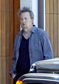 Matthew Perry is seen in public for the first time in six months as he emerges from lockdown looking scruffy and disheveled.