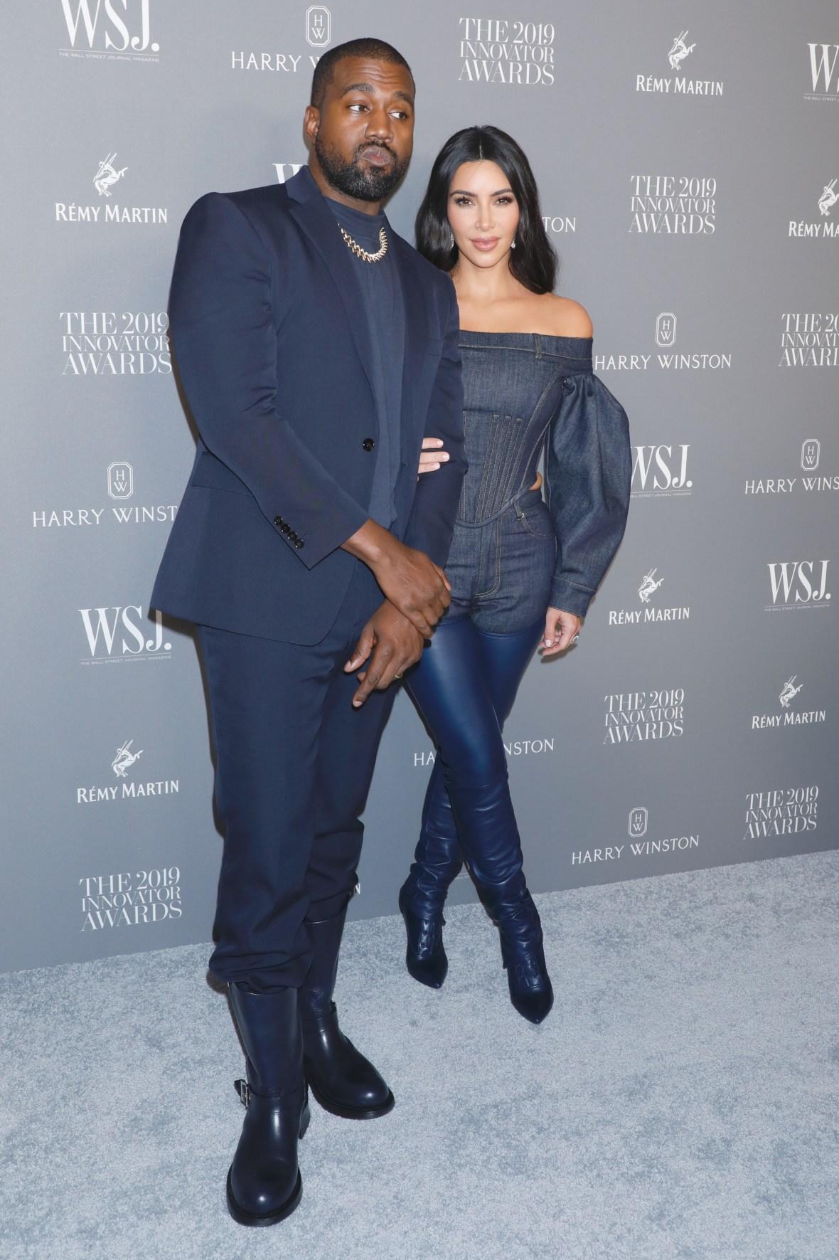 Kim Kardashian Holding Husband Kanye West's Arm