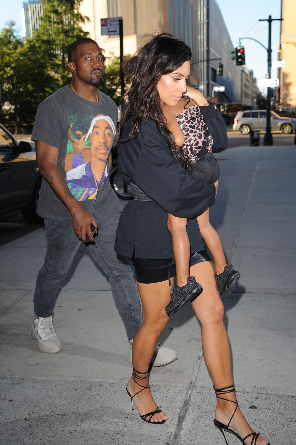 Kim Kardashian Holds North While Walking With Kanye West