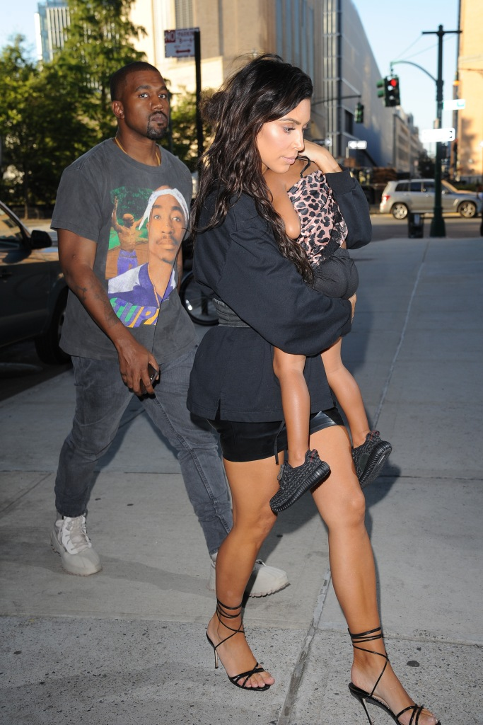 Kim Kardashian Holds North While Walking With Kanye West