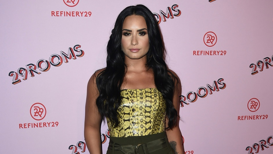 Demi Lovato Smiles in High Waisted Pants and Snake Skin Top
