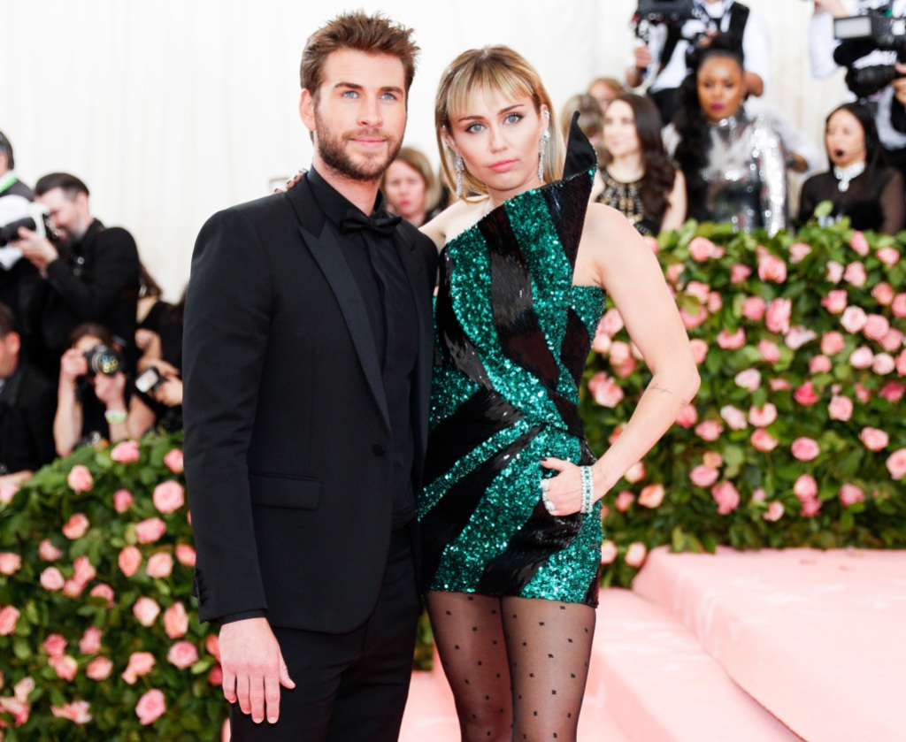Miley Cyrus Wears Green and Black Dress With Then Husband Liam Hemsworth at the 2019 Met Gala