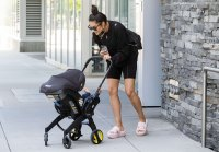 Shay Mitchell Out with her Baby and Wearing Ugg Fluffita Slide Ons
