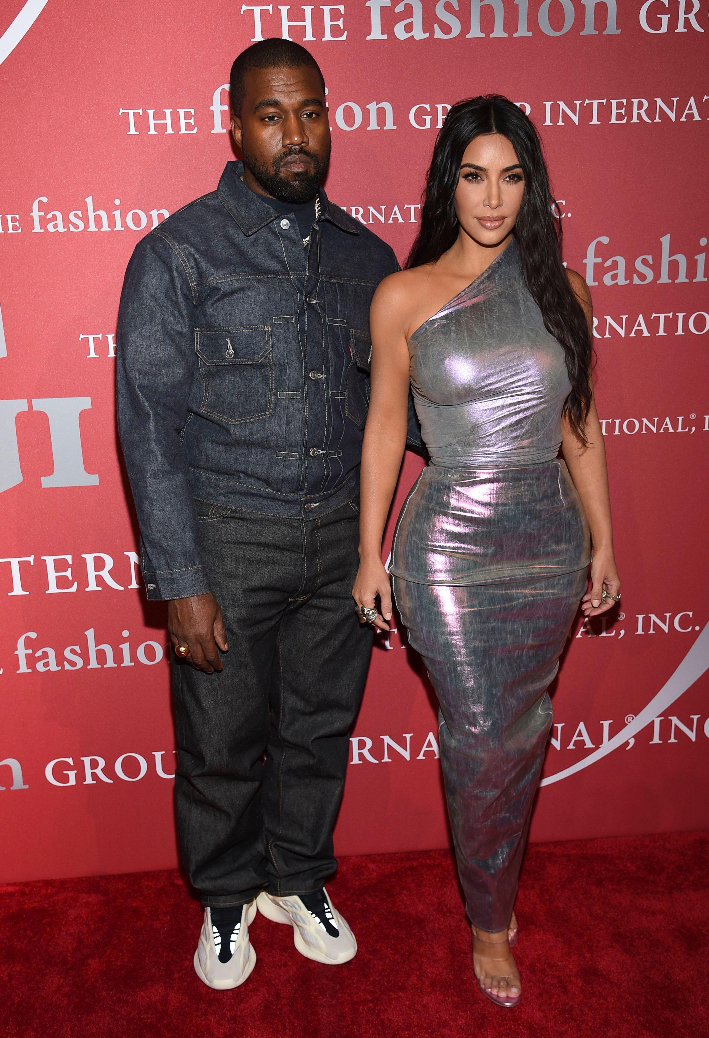 Kim Kardashian Shares Throwback Wedding Dress Photo Amid Drama
