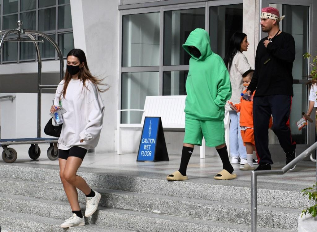 Scott Disick and Amelia Gray Hamlin Leave Miami With His Kids 8